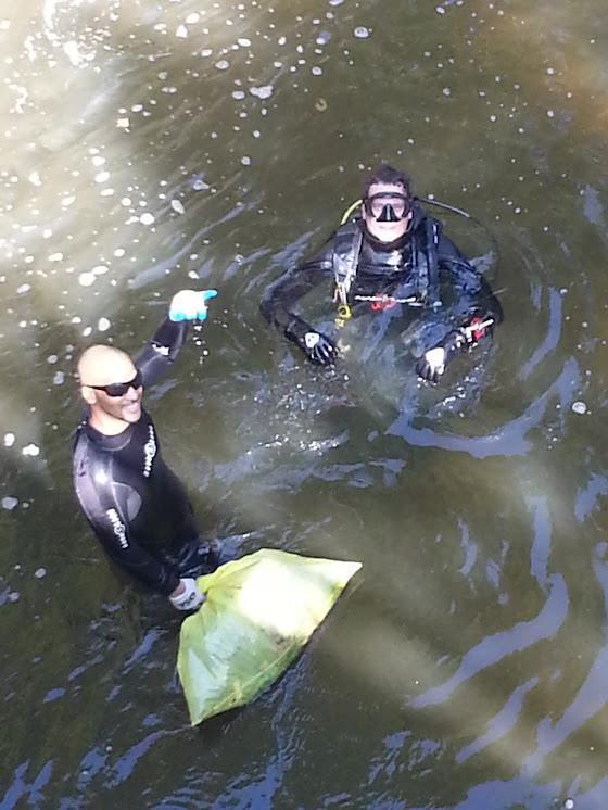Divers collecting debris
